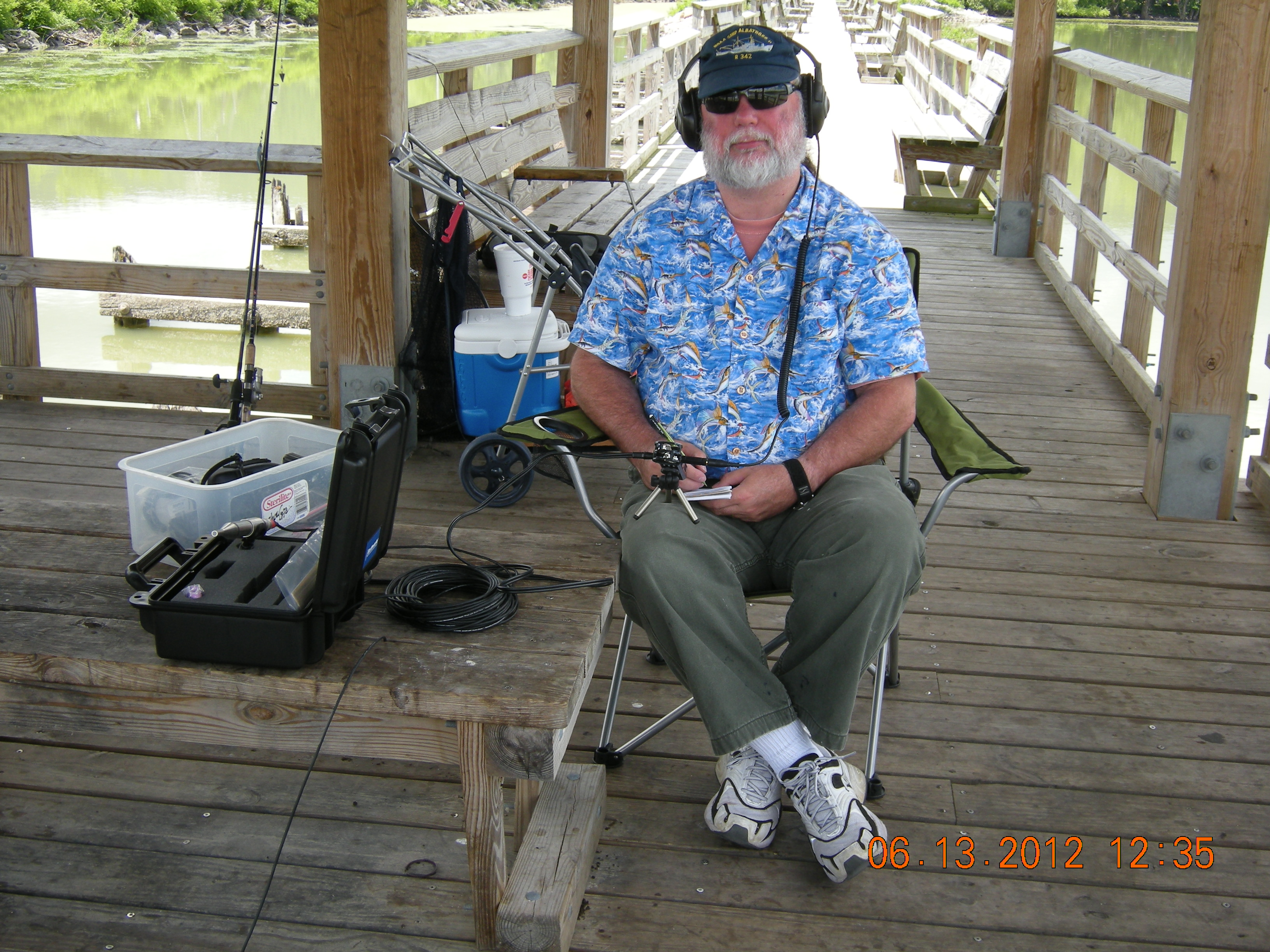 Rodney Rountree listening to fish in Lake Champlain